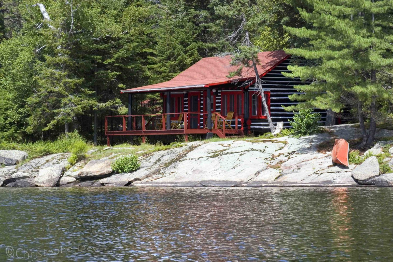 Killarney Lodge rustic cabin on the lake shore in summer