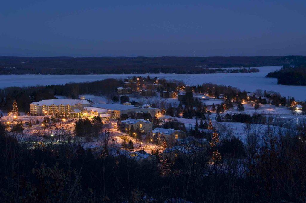 Deerhurst Resort in Huntsville aerial view at night in winter