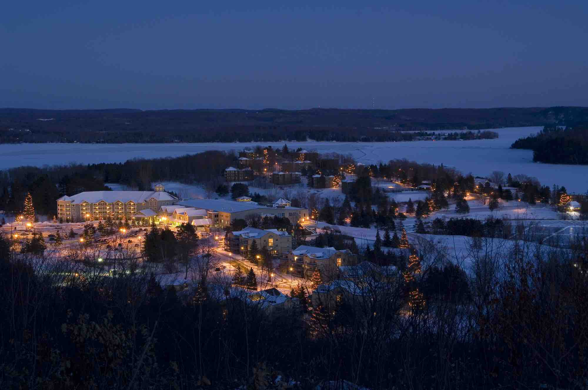 Deerhurst Resort in Huntsville aerial view at night in winter of one of the top luxury muskoka resorts