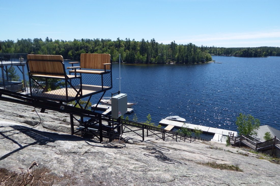 Cottage Lifts' elevation solutions with lake view from cottage