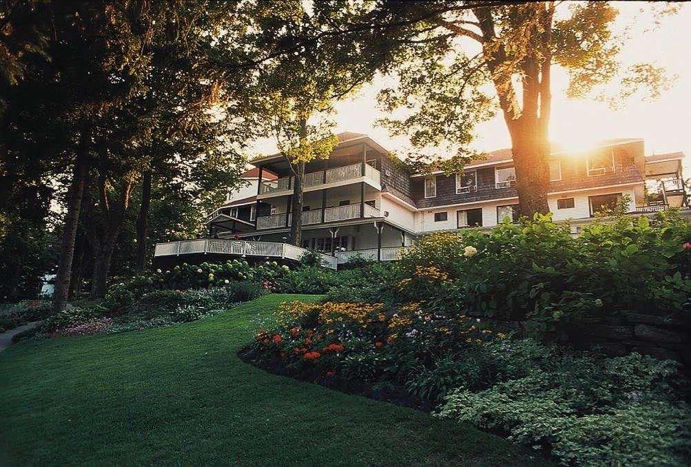 Clevelands House   luxury muskoka resorts front porch at sunset