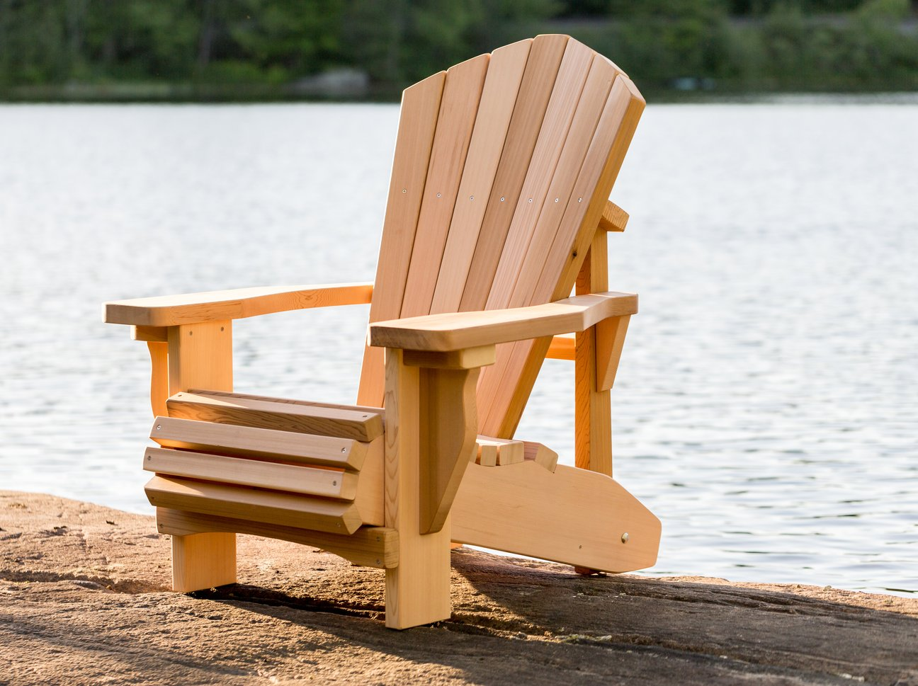 Muskoka Chair Company- Muskoka chair beside lake