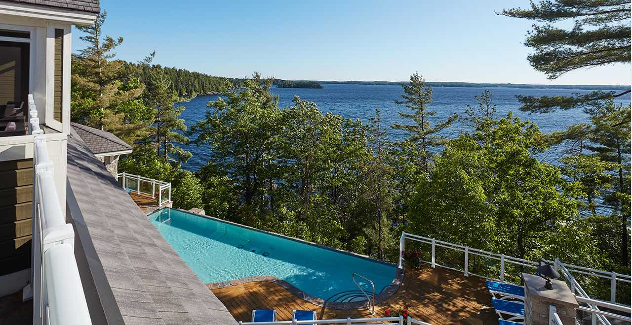 Touchstone Resort - view from patio over pool and Lake Muskoka is living in Bracebridge Ontario at its best